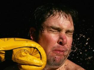 fist hitting face